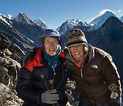 Carol and Leslie top out at 17,000 feet elevation, most of the way up Gokyo Ri, within view of Mount Everest (upper right: 29,035 feet / 8850 meters elevation above sea level from 1999 GPS measurement), in Sagarmatha National Park, Nepal, Asia. Sagarmatha National Park was created in 1976 and honored as a UNESCO World Heritage Site in 1979. For licensing options, please inquire.
