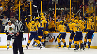 NASHVILLE, TN - APRIL 17:  The Nashville Predators charge the ice after defeating the Chicago Blackhawks in overtime in Game Three of the Western Conference First Round during the 2017 NHL Stanley Cup Playoffs at Bridgestone Arena on April 17, 2017 in Nashville, Tennessee.  (Photo by Frederick Breedon/Getty Images)
