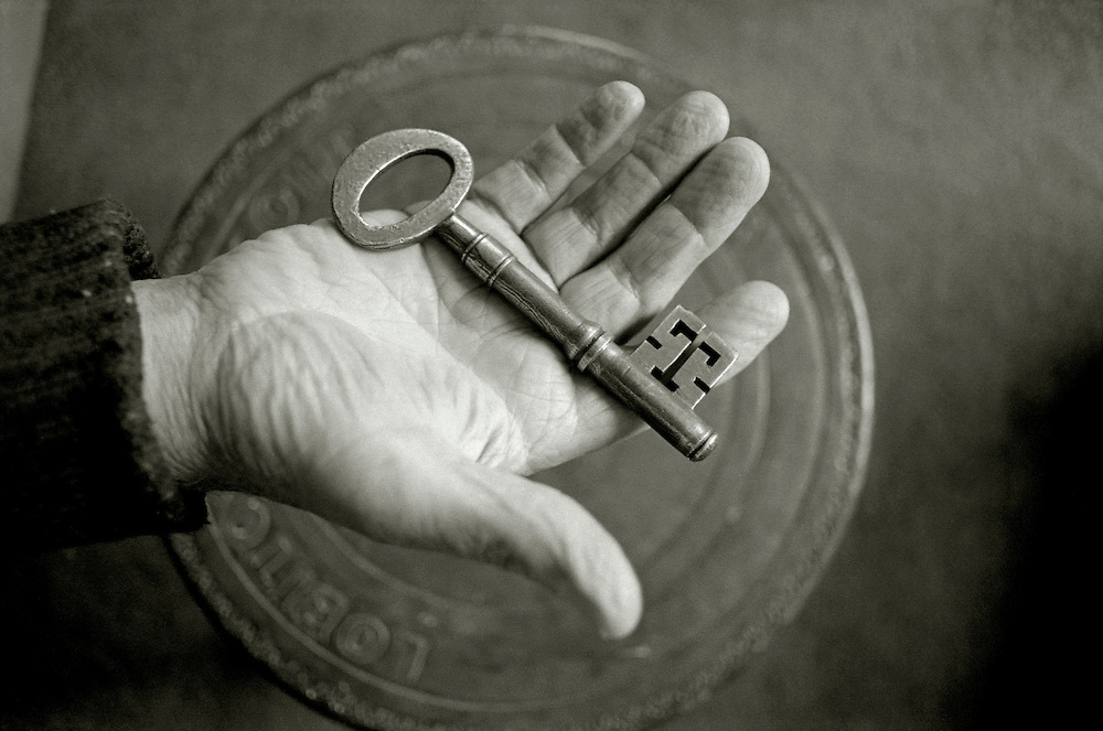 My father holds the key to the house he was born in. Lochranza, Isle Of Arran, Scotland.<br /> [This photograph is currently licensed through Millennium Images - please contact the photographer for details]
