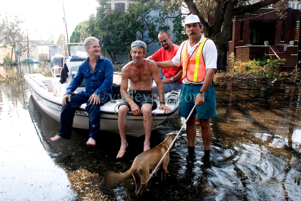 05 Sept  2005. New Orleans, Louisiana. Post hurricane Katrina.<br /> Animal rescue boat. Local man Jimmy Delery (rt) and his merry band of locals assist in the search and rescue animals from the devastating floods in Uptown New Orleans.<br /> Photo; ©Charlie Varley/varleypix.com