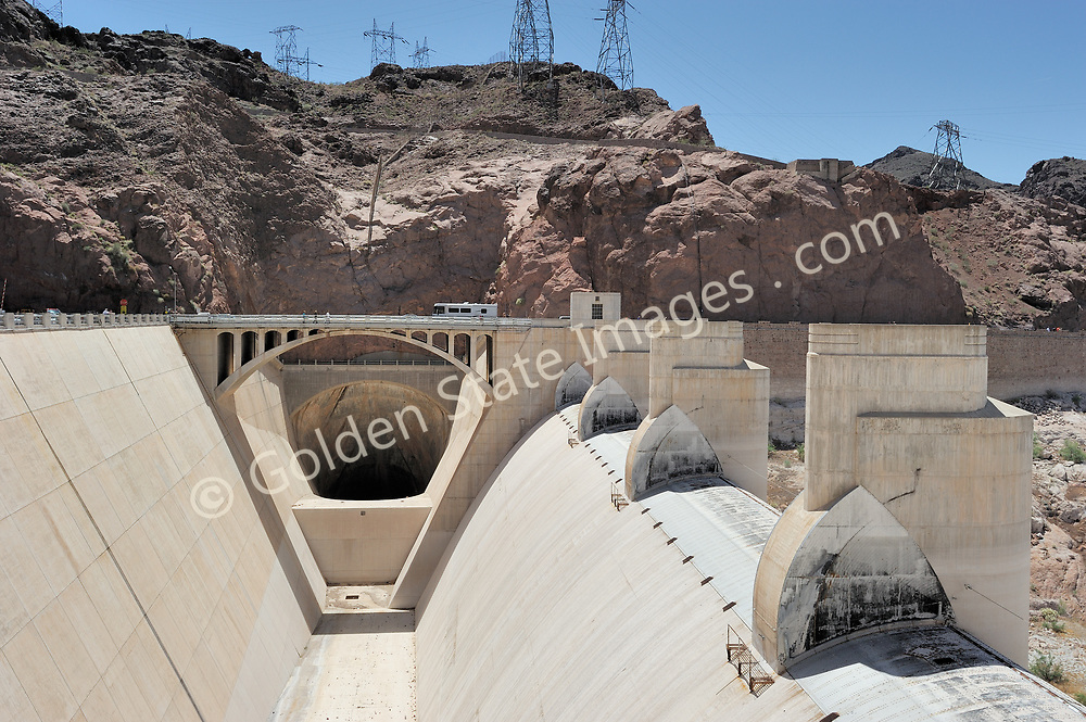 The Arizona side spillway at Hoover Dam. <br /> <br /> Hoover Dam is designed to never have the water level of Lake Mead overtop the dam. There are spillways on each side which route excess storage around the dam.