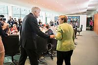 29 AUG 2018, BERLIN/GERMANY:<br /> Horst Seehofer (L), CSU, Bundesinnenminister, und Angela Merkel (R), CDU, Bundeskanzlerin, im Gespraech, vor Beginn der Kabinettsitzung, Bundeskanzleramt<br /> IMAGE: 20180829-01-045<br /> KEYWORDS: Kabinett, Sitzung, Gespräch