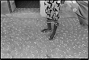 The footprint of one person is narrow.  Congolese proverb<br /> <br /> During the Peul Crossing of the Cattle festival the houses are cleaned, painted and decorated. This courtyard was decorated with a cat's paw pattern created by three fingers dipped in white wash. Diafarabé, Mali. 1994