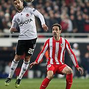Besiktas's Simao Sabrosa (L) and Atletico Madrid's Juanfran (R) during their UEFA Europa League Round of 16, Second leg soccer match Besiktas between Atletico Madrid at Inonu stadium in Istanbul Turkey on Thursday March 15, 2012. Photo by TURKPIX