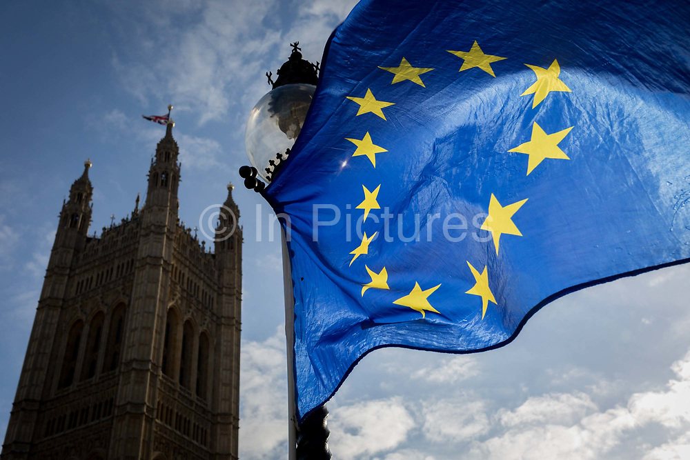 The stars of the EU flag fly over the Victoria Tower at the  Houses of Parliament in Westminster, seat of government and power of the United Kingdom during Brexit negotiations with Brussels, on 30th January 2018, in London England.