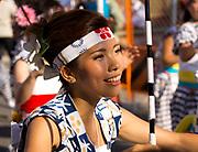 Women dancing with umbrellas in the Tenjin Festival (Tenjin Matsuri) in Osaka.