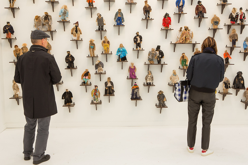 """New York, NY - 6 May 2016. Frieze New York art fair. A wall filled with figures made of natural materials by Jos de Gruyter and Harald Thys, titled """"I piccoli pupazzi sporchi di Pruppà (The small dirty puppets from Pruppa) in the gallery of Gavin Brown Enterprises."""