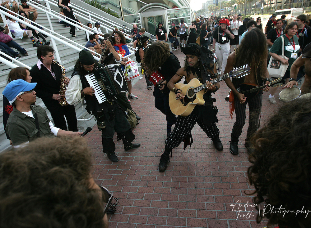 """Andrew Foulk/ Zuma Press.July 24, 2009, San Diego, California, USA. Comic Con. A band of """"Pirate"""" musicians perform outside the San Diego Convention center for  Comic Con attendee , during day two of the 40th annual San Diego International Comic Con."""