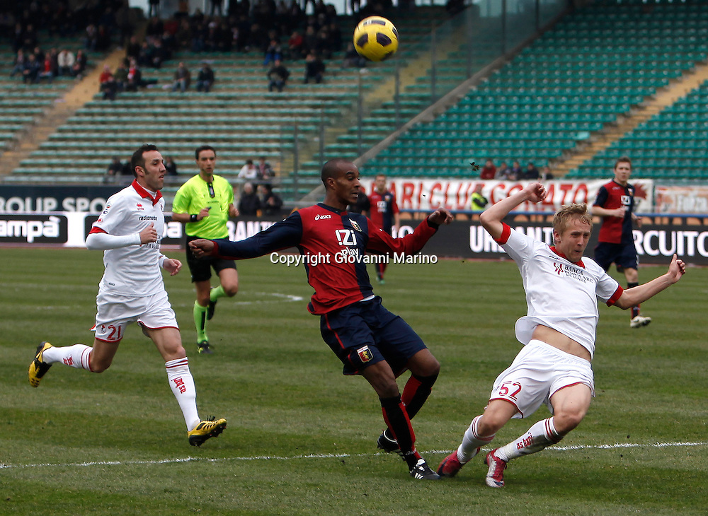 Bari (BA), 13-02-2011 ITALY - Italian Soccer Championship Day 25 - Bari VS Genoa..Pictured: Konko (GE) Glik (BA).Photo by Giovanni Marino/OTNPhotos . Obligatory Credit