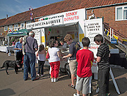 People queueing at donut and coffee stall, Woodbridge, Suffolk, England