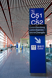Modern departure gate signs inside new Terminal 3 at Beijing International Airport 2009