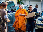 03 NOVEMBER 2018 - BANGKOK, THAILAND:  Buddhist monks walk into Wat Debsirin on the first day of funeral rites for Vichai Srivaddhanaprabha. Vichai was the owner of King Power, a Thai duty free conglomerate, and the Leicester City Club, a British Premier League football (soccer) team. He died in a helicopter crash in the parking lot of the King Power stadium in Leicester after a match on October 27. Vichai was Thailand's 5th richest man. The funeral is expected to last one week.    PHOTO BY JACK KURTZ
