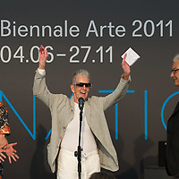VENICE, ITALY - JUNE 04:  Artist  Elaine Sturtevant (C) Bice Curiger Director of 54th Biennale Art 20111 (L) and Paolo Baratta President Biennale Venice (R) at the Official Awards  of the 54th International Art Exhibition on June 4, 2011 in Venice, Italy. This year's Biennale is the 54th edition and will run from June 4th until 27 November.