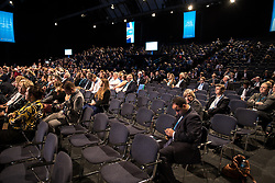 © Licensed to London News Pictures  . 03/10/2017 . Manchester , UK . Half empty auditorium with many empty seats ahead of the Home Secretary's speech , during day three of the Conservative Party Conference at the Manchester Central Convention Centre . Photo credit : Joel Goodman/LNP