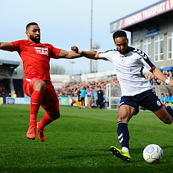 TELFORD COPYRIGHT MIKE SHERIDAN 23/3/2019 - Brendon Daniels of AFC Telford crosses under pressure from Jamie Turley of Orient during the FA Trophy Semi Final fixture between AFC Telford United and Leyton Orient at the New Bucks Head