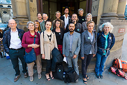 © Licensed to London News Pictures. 13/09/2019. London, UK. A number of Extinction Rebellion defendants who will appear before magistrates today with their supporters pose for a photograph outside City of London Magistrates Court this morning. Over 50 defendants from across the UK are appearing at City of London Magistrates court in London today, charged with being public assembly participants failing to comply with police conditions related to Extinction Rebellion climate change protests in London. Photo credit: Vickie Flores/LNP