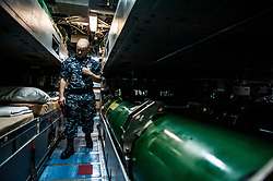 YOKOSUKA, Japan (June 9, 2014) Electronics Technician 1st Class Kevin Watson, from Houston, stands a roving security watch aboard the Virginia-class fast attack submarine USS North Carolina (SSN 777). North Carolina is visiting Fleet Activities Yokosuka, Japan, during a routine deployment to the Indo-Asia-Pacific.  (U.S. Navy photo by Mass Communication Specialist 3rd Class Liam Kennedy/Released) 140609-N-BD107-066 <br /> Join the conversation<br /> http://www.facebook.com/USNavy<br /> http://www.twitter.com/USNavy<br /> http://navylive.dodlive.mil
