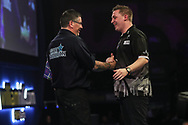 Gary Anderson and Chris Dobey at the end of their fourth round match during the World Darts Championships 2018 at Alexandra Palace, London, United Kingdom on 27 December 2018.