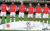 Arsenal players : Kanu, Thierry Henry, Dennis Bergkamp, Ray Parlour, Martin Keown and Oleg Luzhny line up before the match . Arsenal 2:0 Lazio, Highbury Stadium, UEFA Champions League, Group B, 27/9/2000. Credit Colorsport / Stuart MacFarlane.