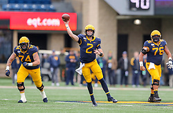 Nov 23, 2019; Morgantown, WV, USA; West Virginia Mountaineers quarterback Jarret Doege (2) throws a pass during the first quarter against the Oklahoma State Cowboys at Mountaineer Field at Milan Puskar Stadium. Mandatory Credit: Ben Queen-USA TODAY Sports