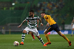 April 12, 2018 - Lisbon, Portugal - Sporting's midfielder Bruno Fernandes from Portugal (L) vies with Atletico Madrids midfielder Saul Niguez of Spain during the UEFA Europa League second leg football match Sporting CP vs Atletico Madrid at Alvalade stadium in Lisbon, on April 12, 2018. (Credit Image: © Pedro Fiuza/NurPhoto via ZUMA Press)