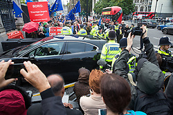 "London, UK. 25 September, 2019. Pro- and anti-Brexit activists protest as MPs arrive at the House of Commons on the day after the Supreme Court ruled that the Prime Minister's decision to suspend parliament was ""unlawful, void and of no effect""."