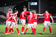 Kayden Jackson of Wrexham is congratulated after scoring his second during the Vanarama National League match between Wrexham AFC and Kidderminster Harriers at the Glyndŵr University Racecourse Stadium, Wrexham, United Kingdom on 23 February 2016. Photo by Mike Sheridan.