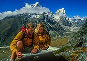 Trekkers map reading, Khumbu Himal, Nepal