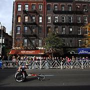A wheelchair athlete in action along First Avenue in Manhattan, New York, during the ING New York Marathon. New York, USA. 3rd November 2013. Photo Tim Clayton