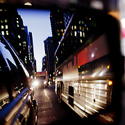 night in the street seen through the mirror of a car