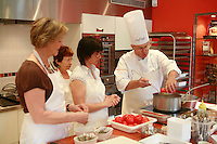 """Lenotre Ecole Culinaire, Paris,..short course - """"Return to the Market"""" with Chef Jacky Legras..working with tomatoes for the confite...photo by Owen Franken for the NY Times..July 12, 2007......."""