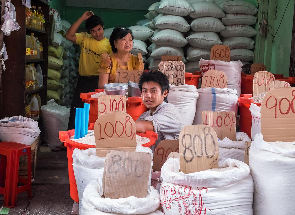 YANGON, MYANMAR - CIRCA DECEMBER 2013: Merchant in the streets of Yangon selling rice.