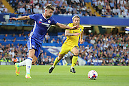 Chelsea defender Gary Cahill (24) clearing from Bristol Rovers midfielder Stuart Sinclair (24) during the EFL Cup match between Chelsea and Bristol Rovers at Stamford Bridge, London, England on 23 August 2016. Photo by Matthew Redman.