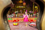 18 JUNE 2013 - YANGON, MYANMAR:  A Chinese-Burmese woman prays in the Kheng Hock Koeng temple in Yangon. It is the largest and busiest Chinese Buddhist/Taoist temple in Yangon.     PHOTO BY JACK KURTZ