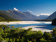 View of the Arawhata River and the Haast Range of the Southern Alps, West Coast, New Zealand.