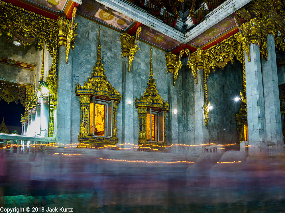 29 MAY 2018 - BANGKOK, THAILAND: People with candles participate in a procession around the prayer hall during Vesak observances at Wat Hua Lamphong in Bangkok. Vesak is the Buddha's birthday, and one of the most important holy days in the Theravada Buddhist religion. Many Thais visit their local temples for Vesak and rededicate themselves to the Dharma, listen to talks about Buddhism and make merit by bringing flowers to the temple.        PHOTO BY JACK KURTZ