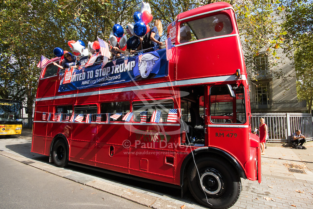 """London, September 21st 2016. A """"Stop Trump"""" open topped red London double-decker bus tours central London in a bid to encourage US expats to vote for Clinton. XXXX."""