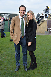 CHARLIE GILKES and ANNEKE VON TROTHA TAYLOR at the 2013 Hennessy Gold Cup at Newbury Racecourse, Berkshire on 30th November 2013.