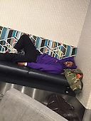 Pictures have emerged Kanye West drunk and asleep in airport