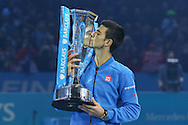 Novak Djokovic with the winning trophy during the final of the ATP World Tour Finals between Roger Federer of Switzerland and Novak Djokovic at the O2 Arena, London, United Kingdom on 22 November 2015. Photo by Phil Duncan.