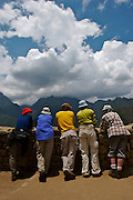 A group of people standing adn admireing the mountains in front of them