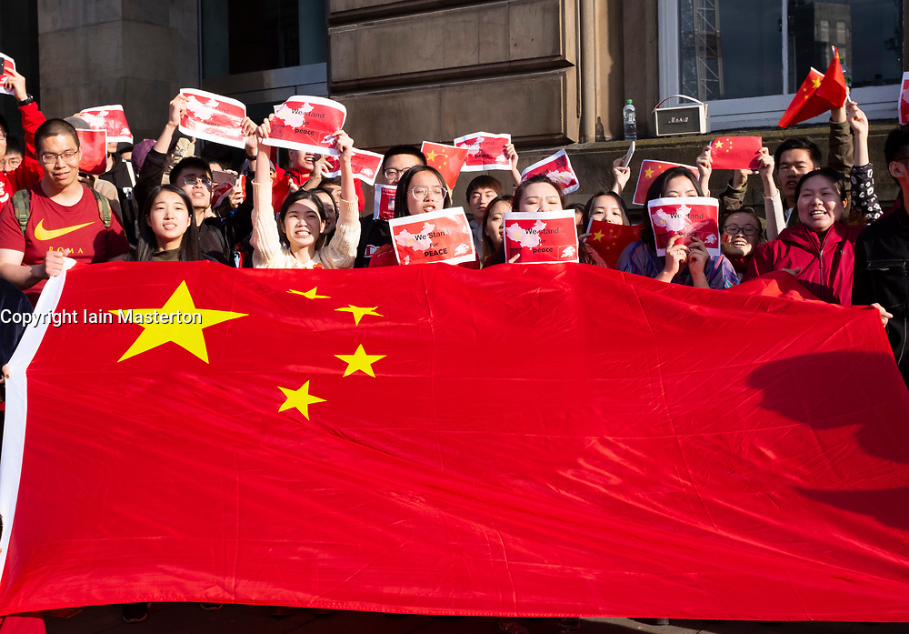 17 August 2019. Pro Beijing Chinese protestors stand opposite a Hong Kong pro-democracy protest on Princes Street in Edinburgh, Scotland, UK