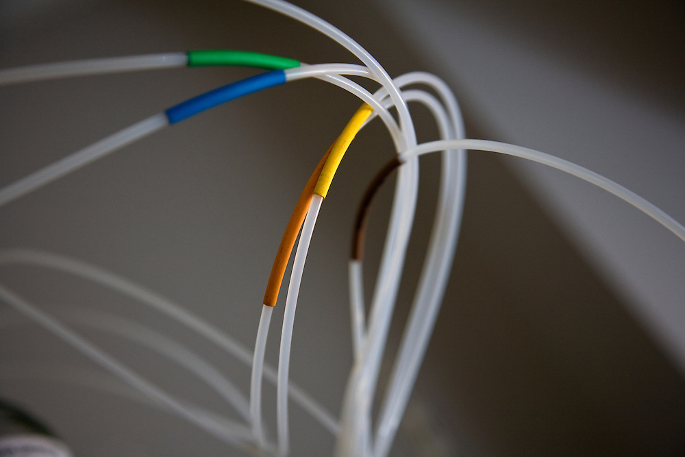 medical scientific colours tubes interconnected joined