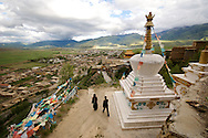 A mother and daughter walk a kora around the Tibetan monastery in Ganze, Tibet (China).