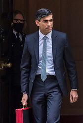 © Licensed to London News Pictures. 03/03/2021. LONDON, UK.  Rishi Sunak, Chancellor of the Exchequer, departs Number 11 Downing Street to deliver his Budget speech in the House of Commons.  It is expected that his statement will cover plans to support the country's economic recovery during the ongoing Covid-19 pandemic, including an extension to the employee furlough scheme.  Photo credit: Stephen Chung/LNP