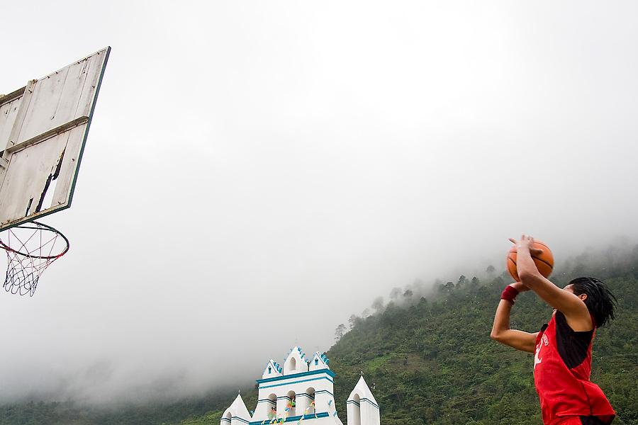 A man takes a jump shot at a basketball tournament held during the patron saint festival at San Pedro Chenalho, a Tzotzil Mayan village outside San Cristobal de las Casas, Chiapas, Mexico on June 27, 2008.