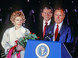 File photo : United States Vice President George H.W. Bush, right, introduces U.S. President Ronald Reagan, center, at a ceremony at Andrews Air Force Base, just outside of Washington, D.C. following the President's return from the Moscow Summit on June 3, 1988. First lady Nancy Reagan is at left.<br /> Credit: Arnie Sachs / CNP/ABACAPRESS.COM