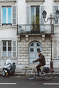Old guy riding a bike in Versailles, France