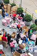 Filipino domestic workers gather on their day-off and prepare shipments to send back home to the Philippines in Central District, Hong Kong. Approximately 130,000 Filipino domestic servants work in Hong Kong and all have Sundays off.
