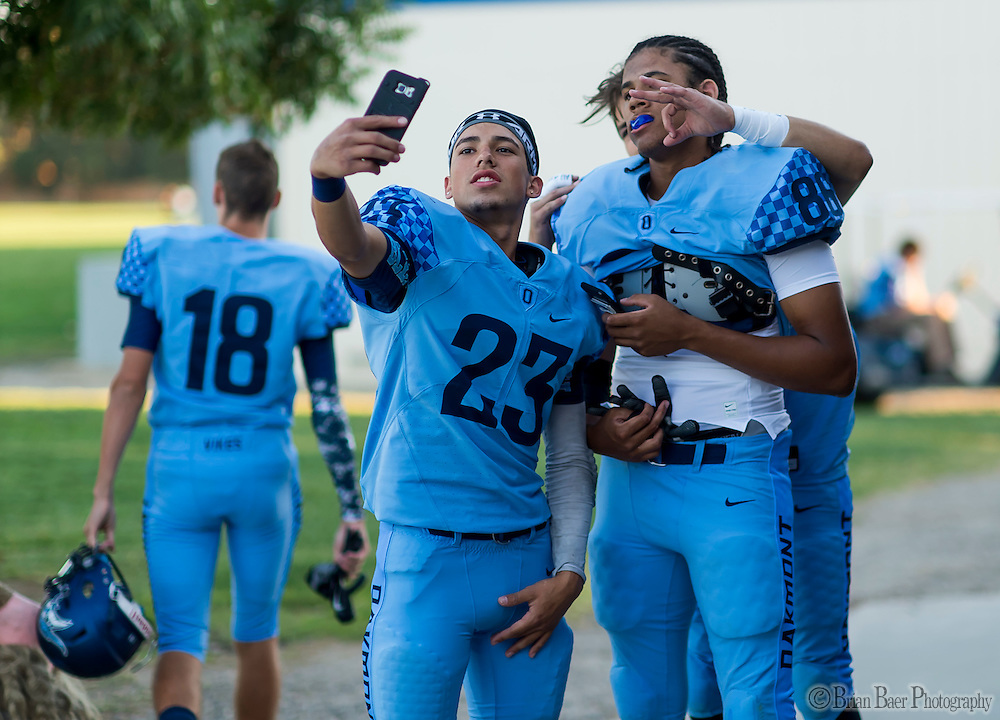 Oakmont High School Vikings players snap a photo before the game as the Oakmont High School Vikings host the Antelope High School Titans Friday Sep 30, 2016.<br /> photo by Brian Baer